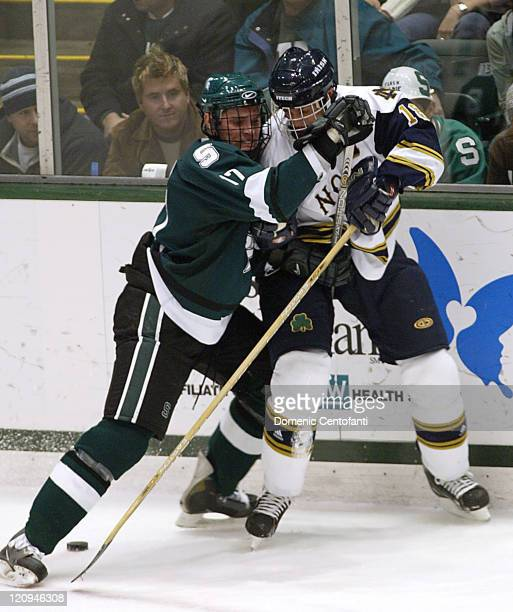 Michigan State freshman left defense AJ Thelen holds up Notre Dame senior right wing Rob Globke The two teams tied 33 after OT