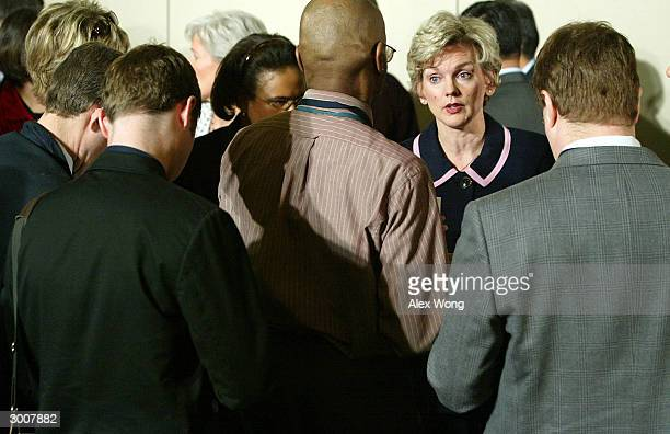 Michigan State Governor Jennifer Granholm answers questions from the media during a news conference February 23 2004 after a meeting with President...