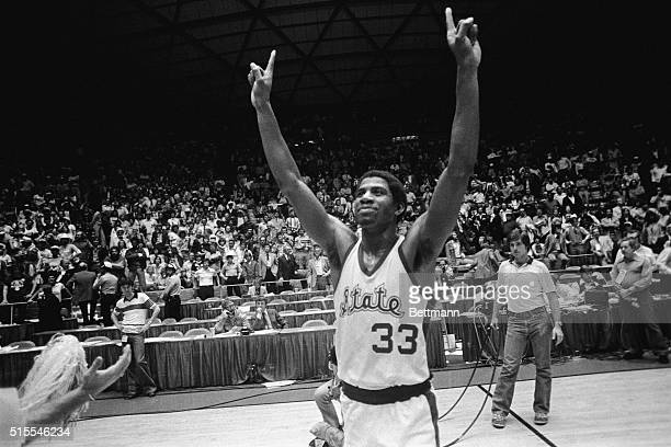 Michigan State guard Earvin Johnson raises his hands and holds up one finger to denote that Michigan State is number ONE after they beat the Indiana...