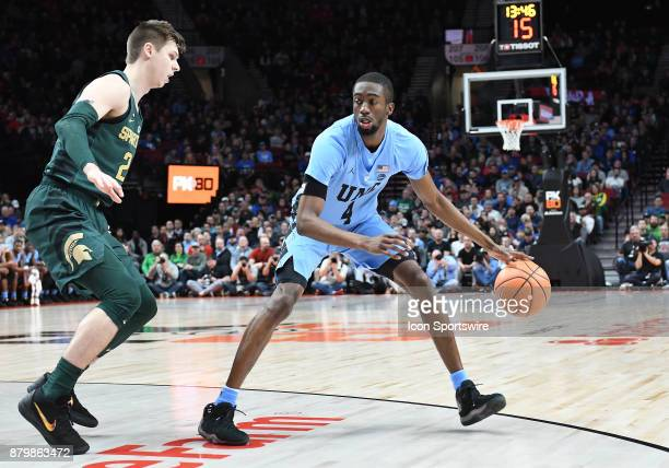 Michigan State guard Matt McQuaid guards North Carolina guard Brandon Robinson in the championship game of the Victory Bracket at the PK80Phil Knight...