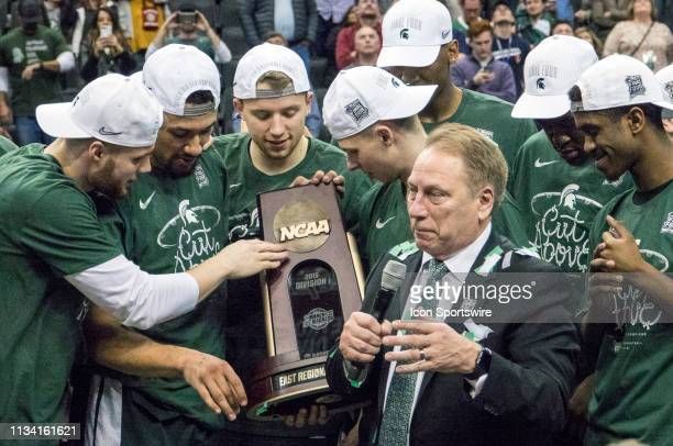 Michigan State players and coach Tom Izzo at the end of the Div 1 Men's championship elite eight game between Duke and Michigan State on March 31 at...