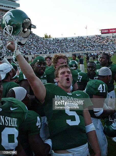 Michigan State quarterback Drew Stanton celebrates after the 4214 victory over Hawaii in East Lansing Michigan on September 10 2005