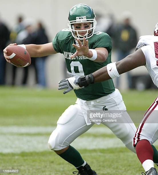 Michigan State quarterback Jeff Smoker evades the rush against the Indiana Smoker completed 32 of 40 passes for 351 yards and two scores to lead No...