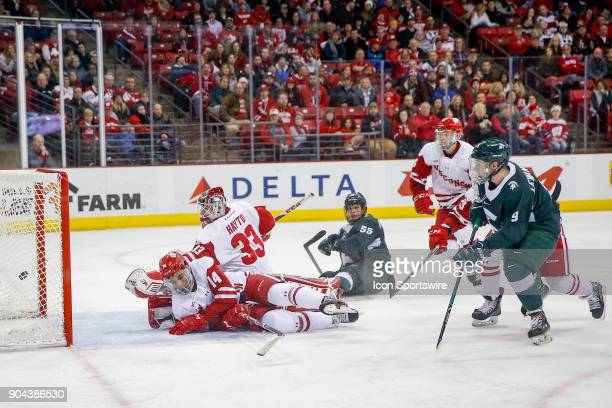Michigan State right wing Mitchell Lewandowski scores the game winning goal as Wisconsin goalie Kyle Hayton watches the puck go into the back of the...