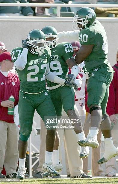 Michigan State sophomore SirDearean Adams gets congratulated by teammates after intercepting a pass by Inidana quarterback Blake Powers in the first...