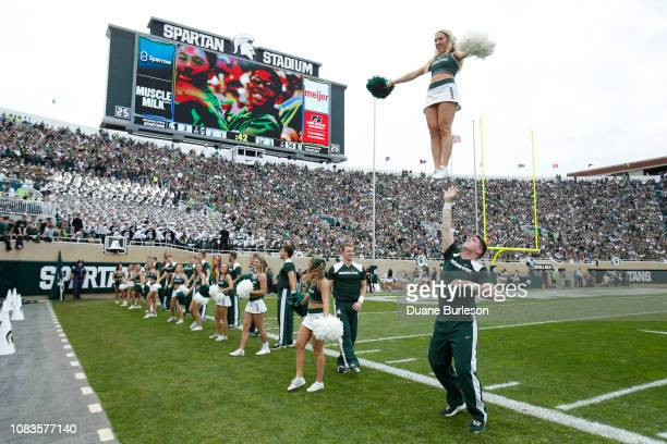 Michigan State Spartan cheerleaders during the first half of a game against the Northwestern Wildcats at Spartan Stadium on October 6 2018 in East...