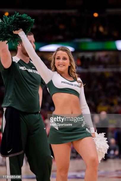 Michigan State Spartans cheerleader is seen during a Big Ten Tournament semifinal game between the Michigan State Spartans and the Wisconsin Badgers...