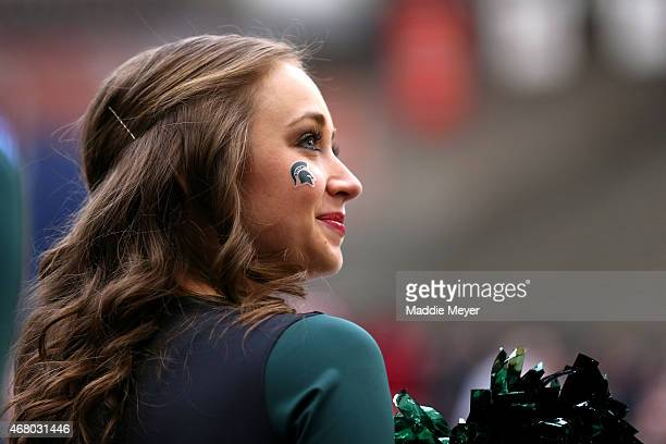 Michigan State Spartans cheerleader looks on against the Louisville Cardinals during the East Regional Final of the 2015 NCAA Men's Basketball...