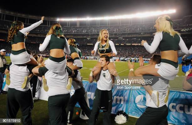 Michigan State Spartans cheerleaders have fun on the field in the second half of the Holiday Bowl played against the Washington State Cougars on...