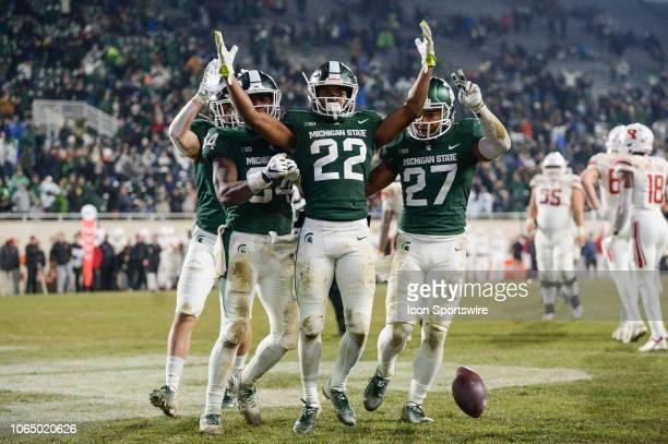 Michigan State Spartans cornerback Josiah Scott celebrates his fourth quarter interception with safety Khari Willis and linebacker Antjuan Simmons...