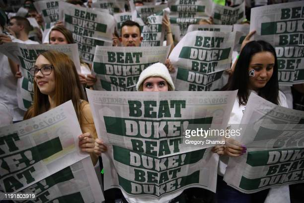 Michigan State Spartans fan looks on while the Duke Blue Devils are introduced at the Breslin Center on December 03, 2019 in East Lansing, Michigan....