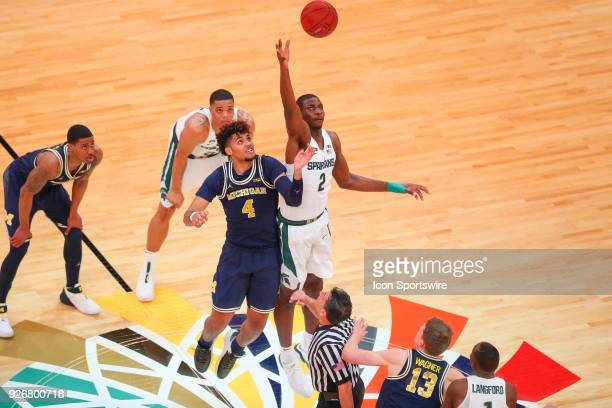Michigan State Spartans forward Jaren Jackson Jr wins the opening tip off against Michigan Wolverines forward Isaiah Livers during the first half of...