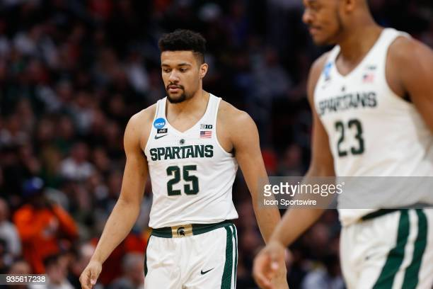 Michigan State Spartans forward Kenny Goins walks up the court during the NCAA Division I Men's Championship Second Round basketball game between the...