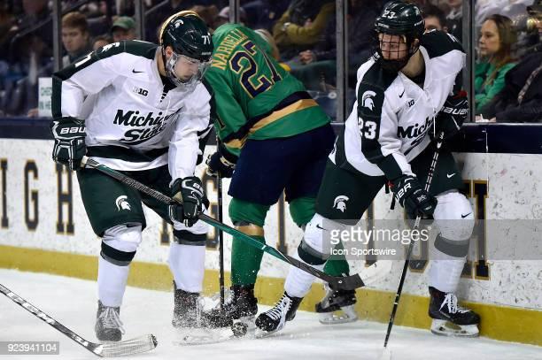 Michigan State Spartans forward Logan Lambdin and Michigan State Spartans forward Cody Milan battle Notre Dame Fighting Irish defenseman Bobby...