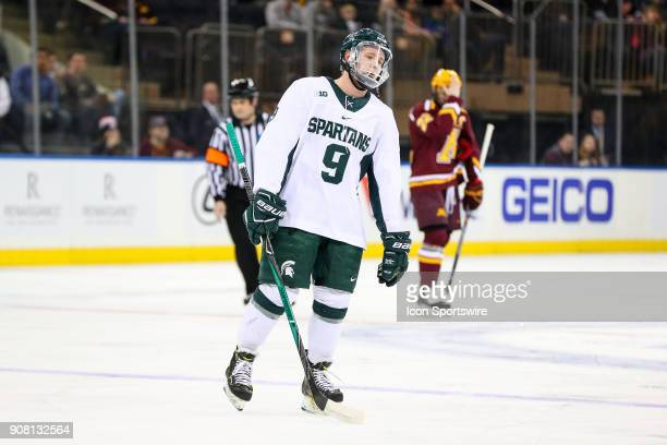 Michigan State Spartans forward Mitchell Lewandowski leaves the ice after getting a major penalty during the first period of the Big Ten Super...
