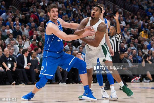 Michigan State Spartans forward Nick Ward and Duke Blue Devils center Antonio Vrankovic battle for position during the State Farm Champions Classic...