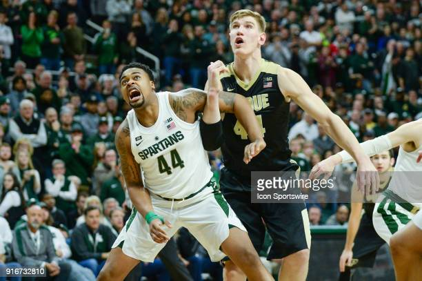 Michigan State Spartans forward Nick Ward and Purdue Boilermakers center Isaac Haas battle for a rebound during a Big Ten Conference college...