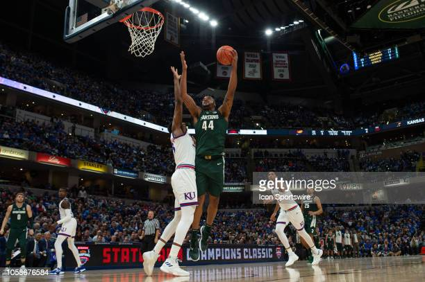 Michigan State Spartans forward Nick Ward drives around Kansas Jayhawks forward David McCormack in the lane during the State Farm Champions Classic...