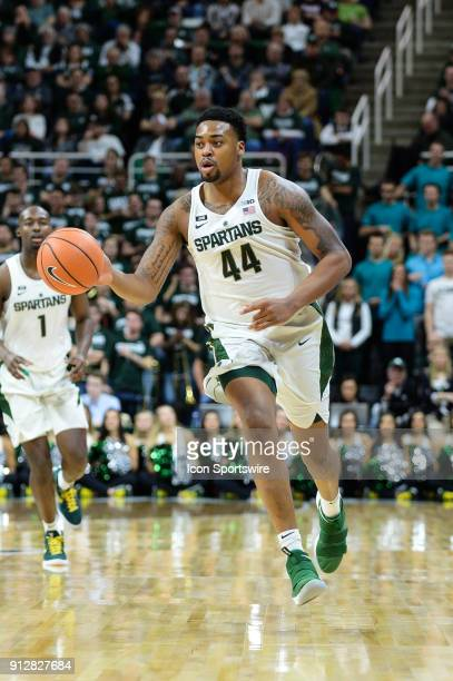 Michigan State Spartans forward Nick Ward leads a fast break during a Big Ten Conference college basketball game between Michigan State and Wisconsin...