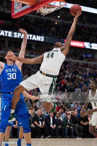 Michigan State Spartans forward Nick Ward shoots over Duke Blue Devils center Antonio Vrankovic in the lane during the State Farm Champions Classic...