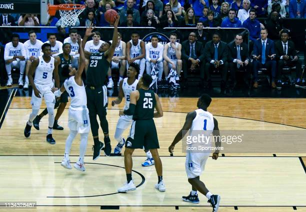 Michigan State Spartans forward Xavier Tillman goes to the basket and scores on March 31 at the Capital One Arena in Washington DC during the...