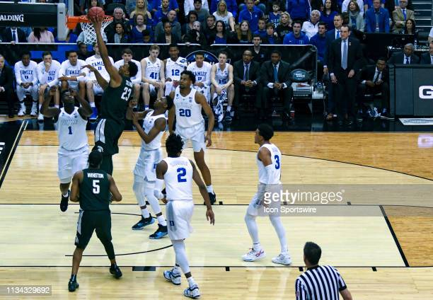 Michigan State Spartans forward Xavier Tillman scores against Duke Blue Devils forward Zion Williamson on March 31 at the Capital One Arena in...