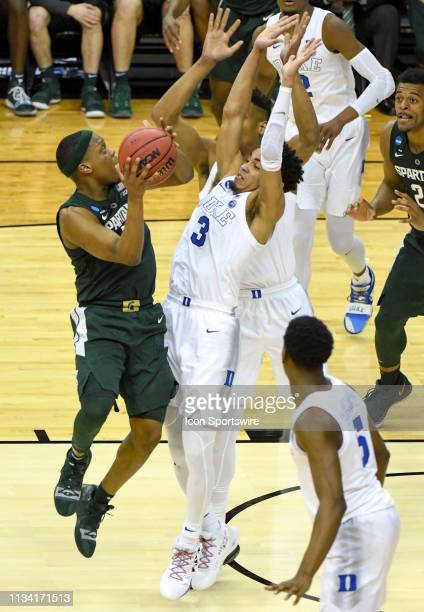 Michigan State Spartans guard Cassius Winston drives on Duke Blue Devils guard Tre Jones on March 31 at the Capital One Arena in Washington DC during...