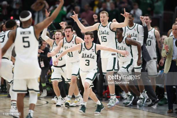 Michigan State Spartans guard Foster Loyer and Michigan State Spartans players celebrate after defeating the Michigan Wolverines in a Big Ten...