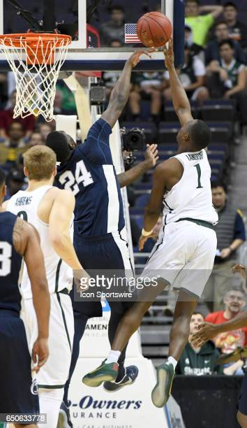 Michigan State Spartans guard Joshua Langford scores against Penn State Nittany Lions forward Mike Watkins in the second round of the Big 10...