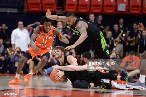 Michigan State Spartans guard Kyle Ahrens and Michigan State Spartans forward Nick Ward battle with Illinois Fighting Illini guard AaronJordan and...