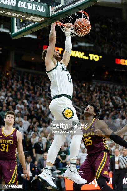 Michigan State Spartans guard Kyle Ahrens slams home two points during a Big Ten Conference college basketball game between Michigan State and...