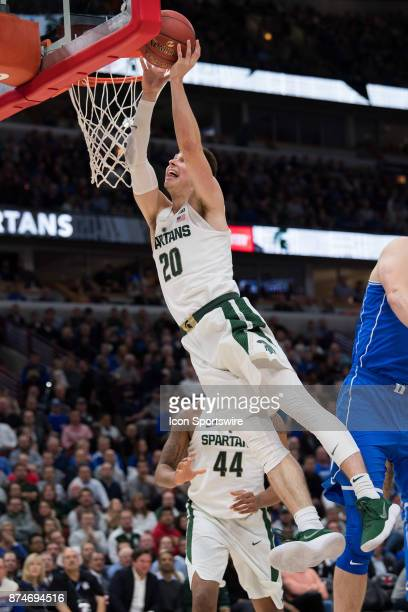 Michigan State Spartans guard Matt McQuaid gets fouled going to the basket by Duke Blue Devils center Antonio Vrankovic during the State Farm...