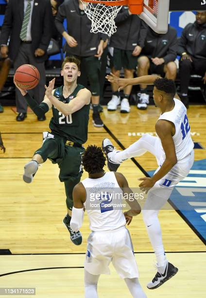 Michigan State Spartans guard Matt McQuaid scores on a reverse layup against Duke Blue Devils forward Javin DeLaurier on March 31 at the Capital One...