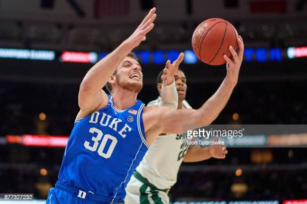 Michigan State Spartans guard Miles Bridges battles with Duke Blue Devils center Antonio Vrankovic for a rebound during the State Farm Classic...