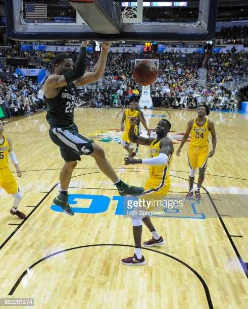 Michigan State Spartans guard Miles Bridges dunks the ball against Minnesota Golden Gophers center Bakary Konate in the third round of the Big 10...