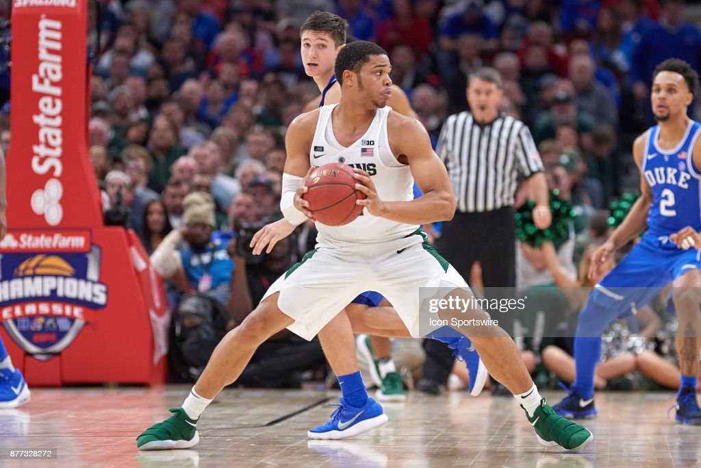 Michigan State Spartans guard Miles Bridges (22) handles the ball during the State Farm Classic Champions Classic game between the Duke Blue Devils and the Michigan State Spartans on November 14, 2017, at the United Center in Chicago, IL.