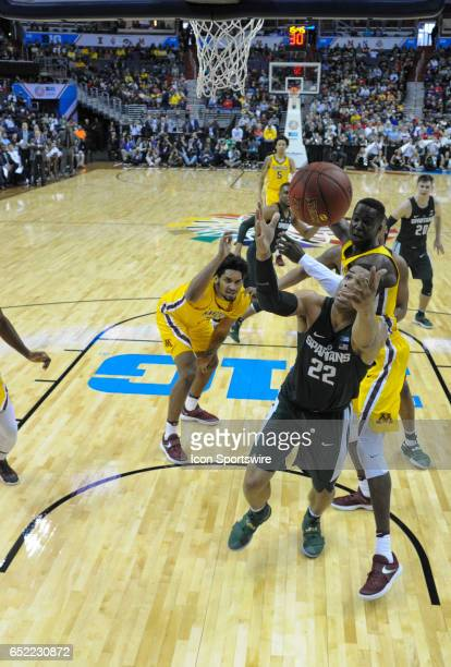 Michigan State Spartans guard Miles Bridges keeps the ball from going out of bounds in front of Minnesota Golden Gophers center Bakary Konate in the...