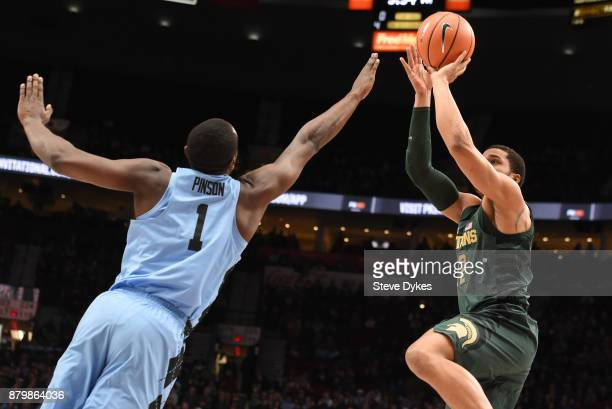 Michigan State Spartans guard Miles Bridges shoots the ball over North Carolina Tar Heels forward Theo Pinson in the first half of the game during...