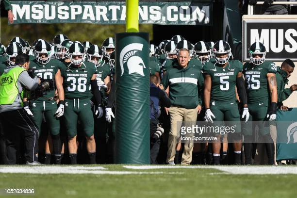 Michigan State Spartans head coach Mark Dantonio and his team prepare to run out of the tunnel prior to a Big Ten Conference college football game...