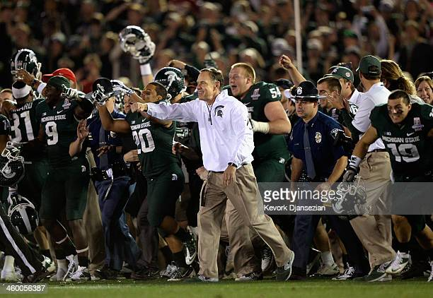 Michigan State Spartans head coach Mark Dantonio celebrates with his team after defeating the Stanford Cardinal 2420 in the 100th Rose Bowl Game...