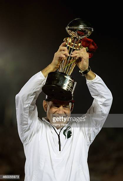 Michigan State Spartans head coach Mark Dantonio celebrates with the Rose Bowl Game trophy after defeating the Stanford Cardinal 2420 in the 100th...