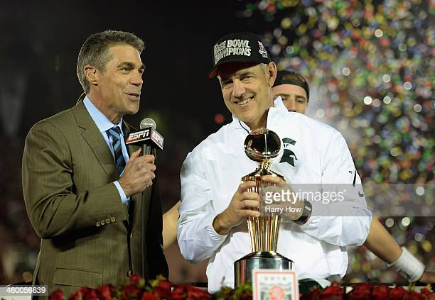 Michigan State Spartans head coach Mark Dantonio is presented the Rose Bowl Game trophy by ESPN's Chris Fowler after defeating the Stanford Cardinal...