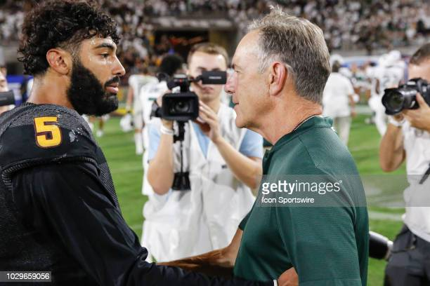 Michigan State Spartans head coach Mark Dantonio shakes Arizona State Sun Devils quarterback Manny Wilkins hand after the college football game...