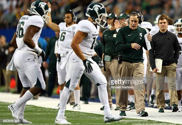 Michigan State Spartans head coach Mark Dantonio walks the sideline against the Baylor Bears during the first half of the Goodyear Cotton Bowl...