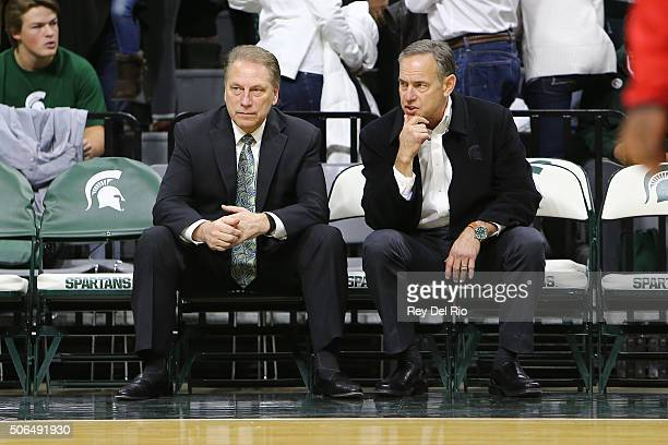 Michigan State Spartans head coach Tom Izzo and Michigan State Spartans head football coach Mark Dantonio on the bench prior to a game against the...