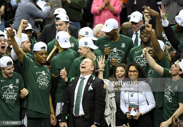 Michigan State Spartans head coach Tom Izzo celebrates with his family and team after defeating the Duke Blue Devils on March 31 at the Capital One...