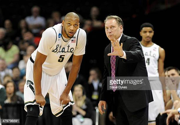 Michigan State Spartans head coach Tom Izzo talks to Adreian Payne during their game against the Delaware Fightin Blue Hens in the second round of...