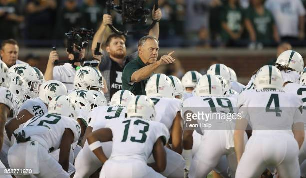 Michigan State Spartans head football coach Mark Dantonio talks with his team prior to the start of the game against the Michigan Wolverines at...