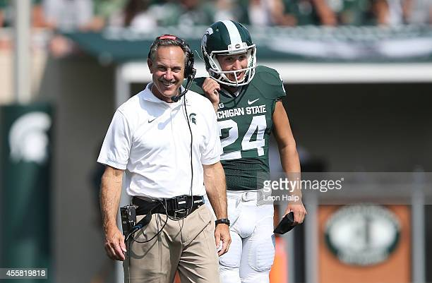 Michigan State Spartans head football coach Mark Dantonio watches the action during the second half of the game against Eastern Michigan Eagles at...