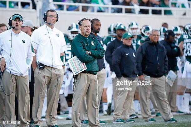 Michigan State Spartans head football coach Mark Dantonio watches the action during the second quarter of the game against the Brigham Young Cougars...